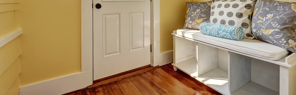 Entryway With Yellow Walls And Storage Bench In White